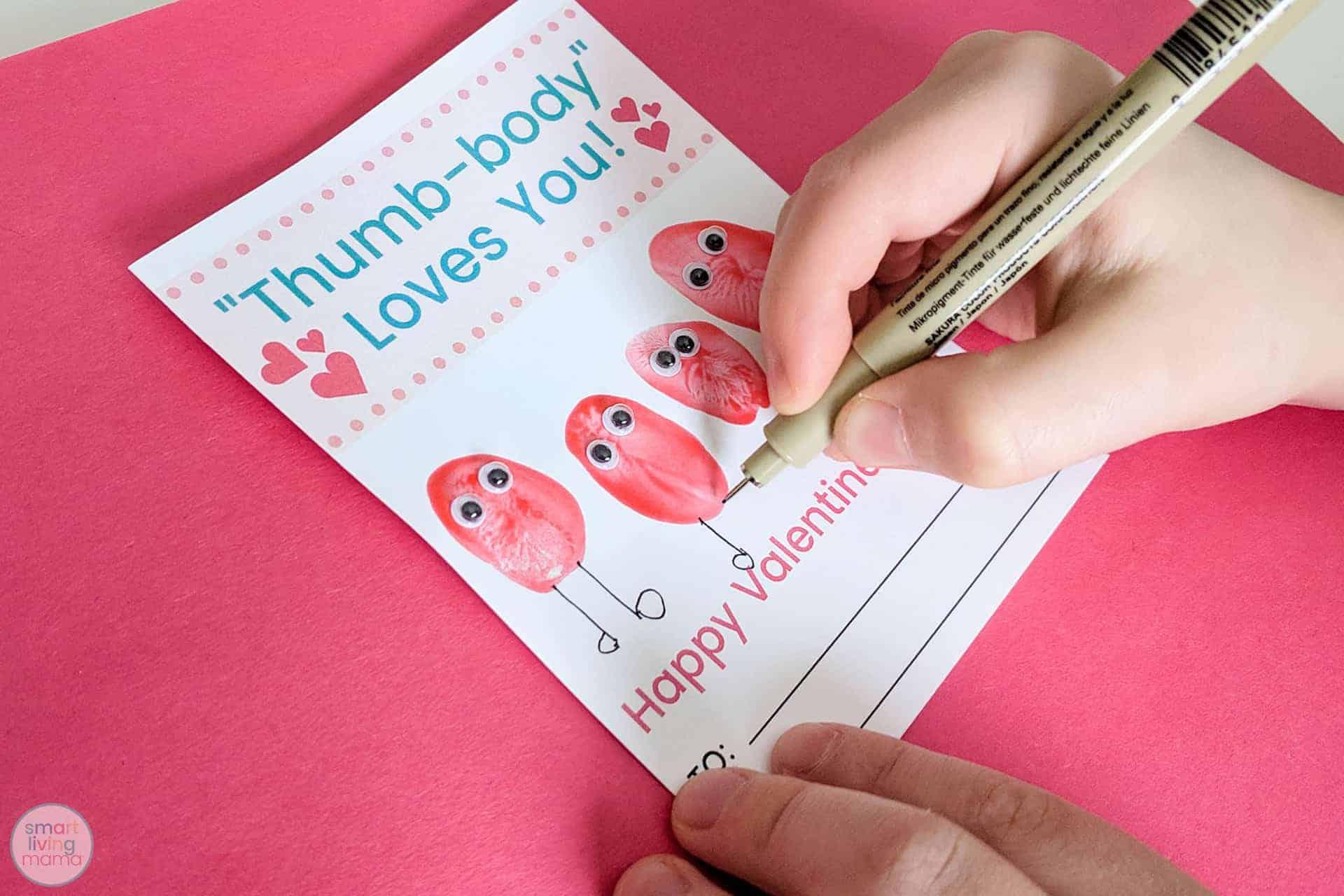 Smart Living Mama - drawing legs on thumbprints