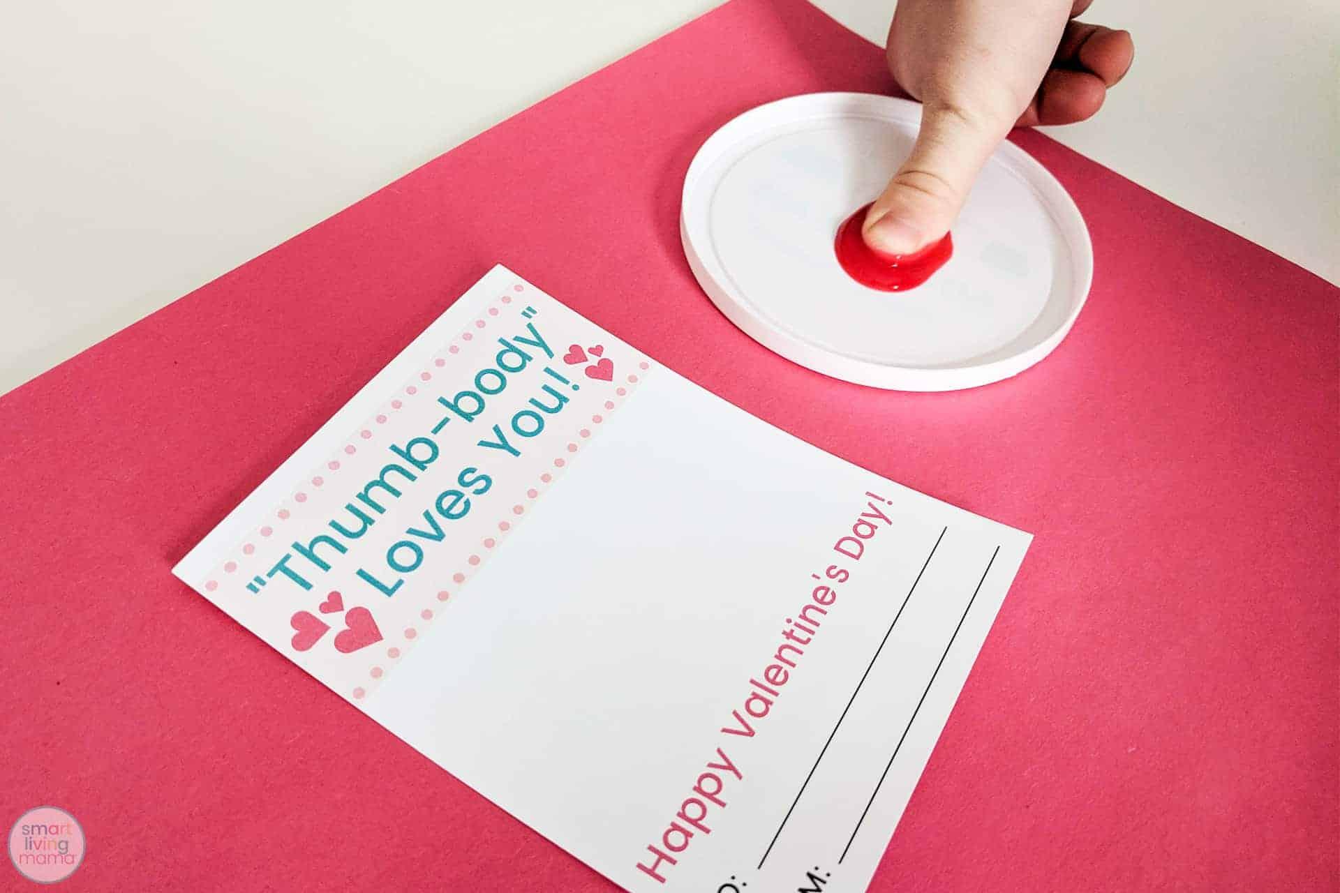 Smart Living Mama - Placing finger into fingerpaint
